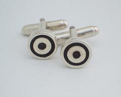 Thumb cufflinks target cufflinks